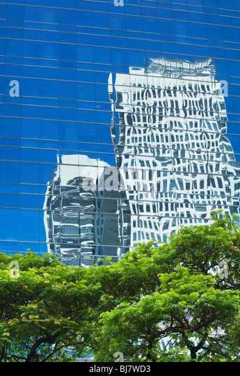 Trees and reflections of skyscrapers Makati; Manila; Philippines - Stock Image