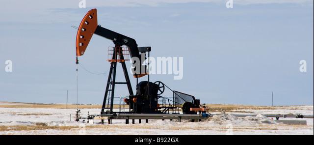 Oil Pumpjack in the Alberta Countryside During Winter - Stock-Bilder