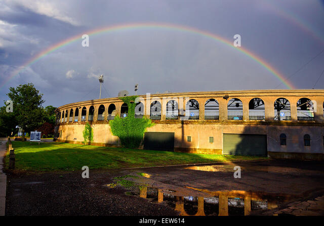 New Haven CT USA-  A rainbow forms over  Yale Field baseball stadium after an early evening shower passed through - Stock Image