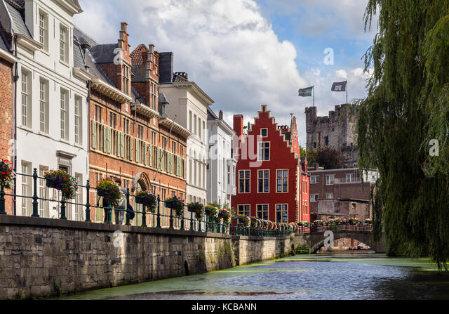 One of the many canals in the city of Ghent in Belgium. Founded in the 10th century, it became the capital of the - Stock Image