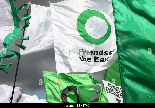 Friends of the earth flags at the put people first demonstration in London. - Stock Image