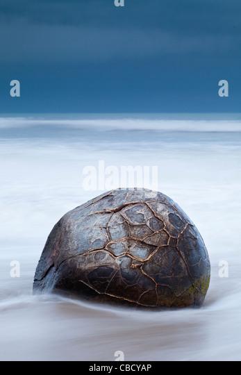 Single boulder at Moeraki Boulders Otago New Zealand - Stock Image