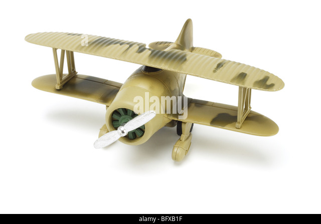 Toy military aircraft with camouflage paint on white background - Stock Image