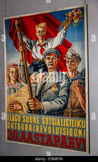 Old communist poster in Estonian, Tallinn, Estonia - Stock Image