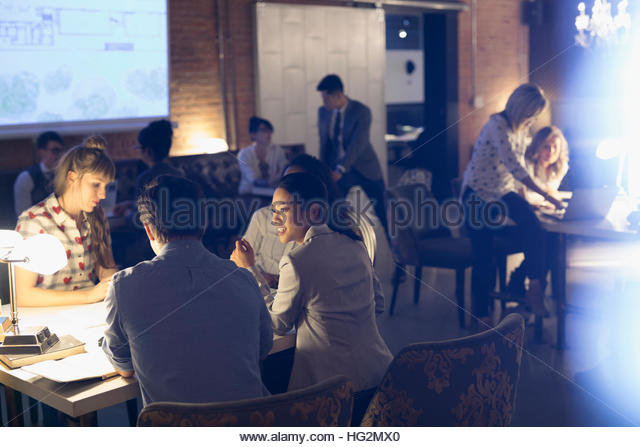 Business people working in focus groups in office - Stock Image