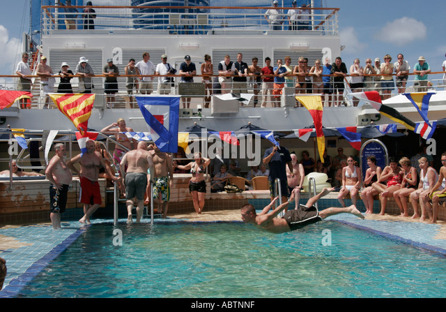 Grand Turk Caribbean Sea Cockburn Town Holland America Line ms Noordam belly flop contest pool - Stock Image