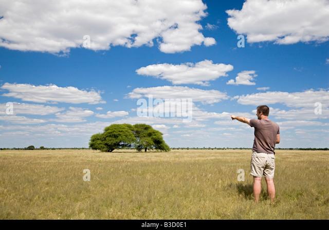 Africa, Botswana, Tourist looking at the landscape - Stock-Bilder