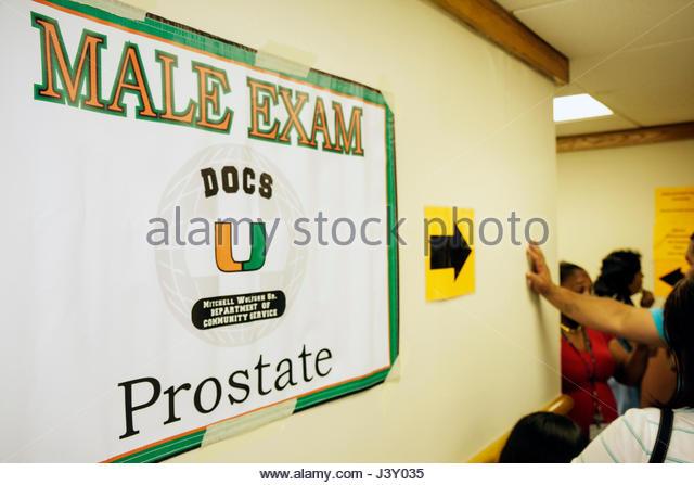 Miami Florida Liberty City Jessie Trice Community Health Center fair free care exam sign male exam prostate cancer - Stock Image