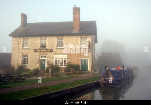 Narrowboat navigating along the English canal system - Stock Image
