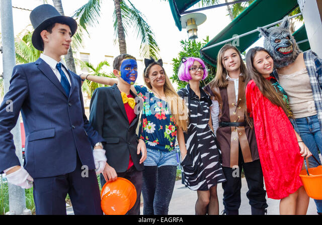 Miami Beach Florida Lincoln Road pedestrian mall Halloween costume wearing outfit character teen boy girl - Stock Image