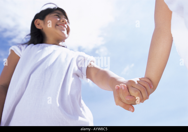 Girl holding her hand with other - Stock-Bilder