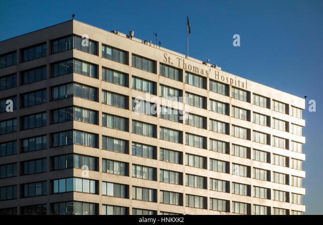 Bright sunlight hitting the side of St Thomas' Hospital building, London, UK - Stock Image
