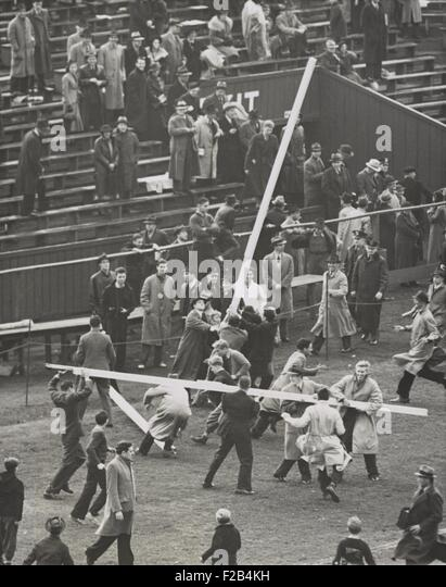 Brown University students tear down the goal posts in celebration of a 7-6 win over Columbia. Oct. 23, 1937. - (BSLOC - Stock Image