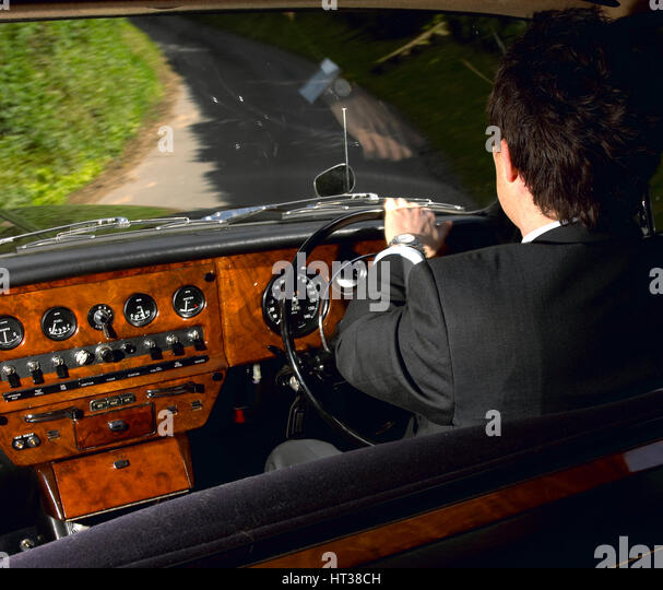 Chauffeur driving 1970 Daimler vanden plas DS 420 limousine. Artist: Unknown. - Stock Image
