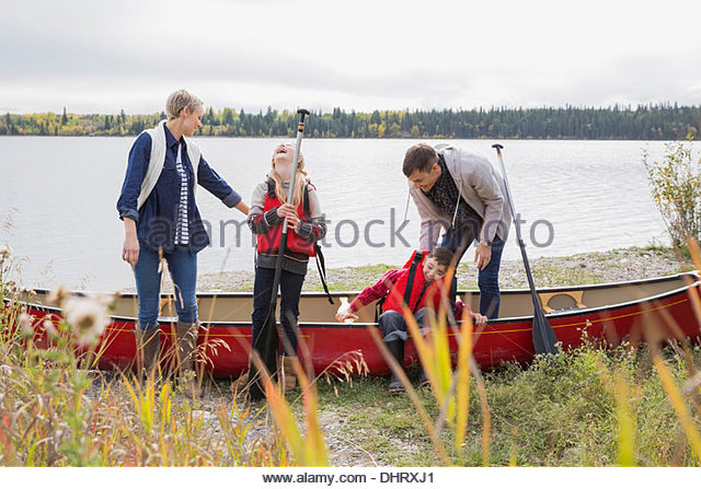 Parents getting kids ready for canoe trip - Stock Image