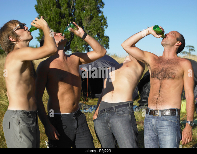 Men drinking beer at a festival - Stock Image