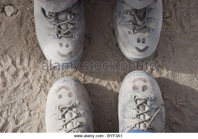 smiley-faces-on-dusty-walking-boots-byf3