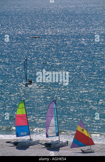 Sailboats glistening beach and water Marco Island FL Florida Southwest Florida Naples area - Stock Image