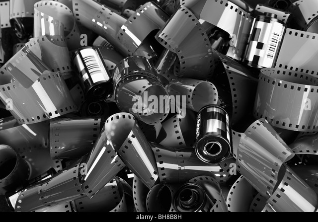 Pile of 35mm photographic film - Stock Image
