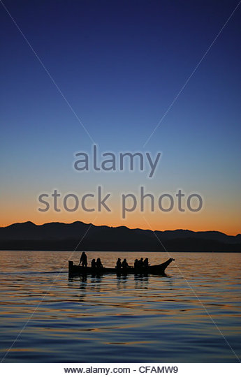 Tla-ook canoe tours at sunset in Tofino, Canada, Vancouver Island, British Columbia, Canada - Stock Image