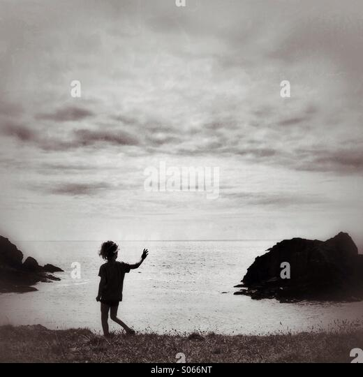 Child on a cliff at Soar mill cove - Stock-Bilder