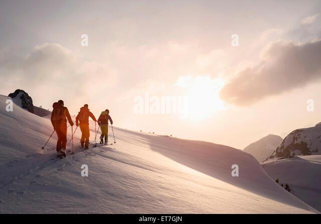 Ski mountaineers climbing on snowy mountain, Tyrol, Austria - Stock Image