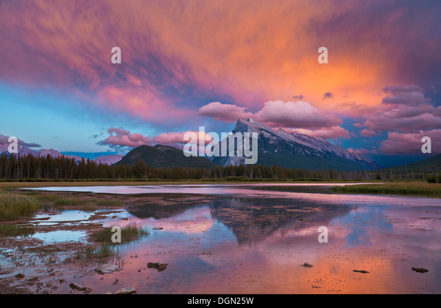 Mount Rundle rising above Banff township from Vermillion lakes drive at sunset  Banff National park Canada North - Stock Image