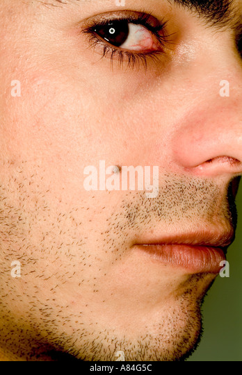 Close-up portrait man looking into camera - Stock Image