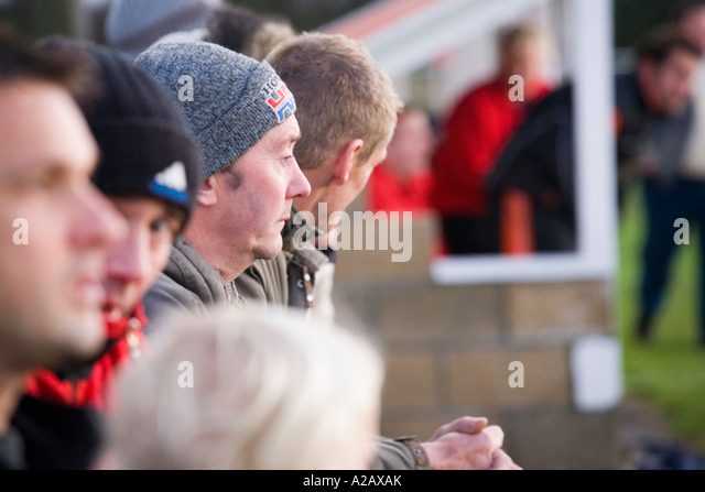 A tense face in the crowd during Ringwood Town FC's 2-0 home victory over Horndean in the Sydenhams Wessex Premier - Stock Image