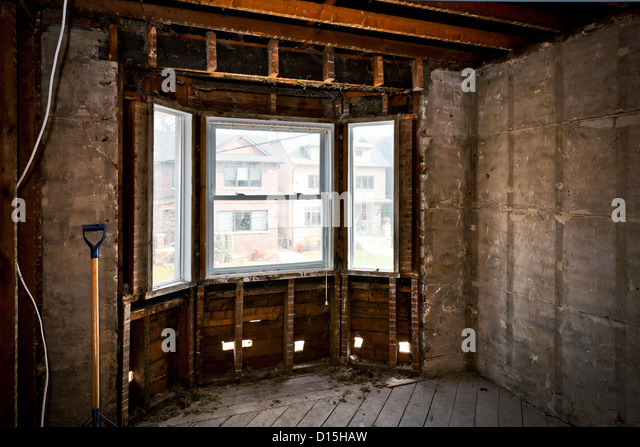 Interior of a house under gut renovation at construction site - Stock Image