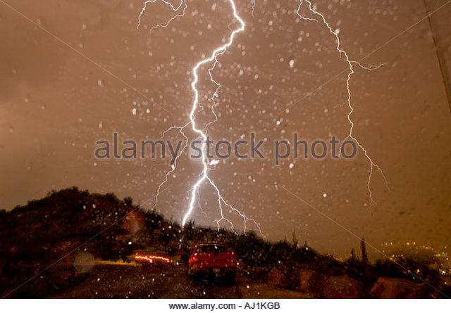 Huge lightning bolt hitting A Mountain Durring a severe thunderstorm in Tucson Arizona Shot  through the Windsheild - Stock Image