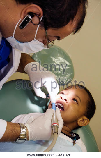 Miami Florida Liberty City Jessie Trice Community Health Center oral health fair free care exam volunteer dental - Stock Image