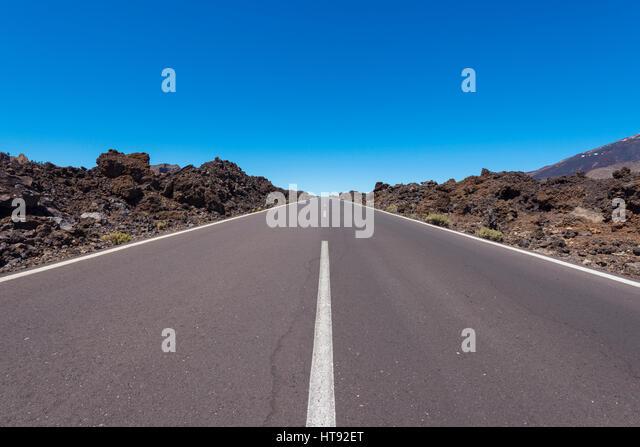 Road through Lava Field in Parque Nacional del Teide, Tenerife, Canary Islands, Spain - Stock Image