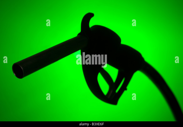 Fuel Pump Silhouette Against A Green Background - Stock Image