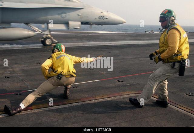 030712-N-4953E-007  The Atlantic Ocean (Jul. 12, 2003) -- Lt. Cmdr. Mike Johnson (right) watches over Lt. Josh Dittmar - Stock Image