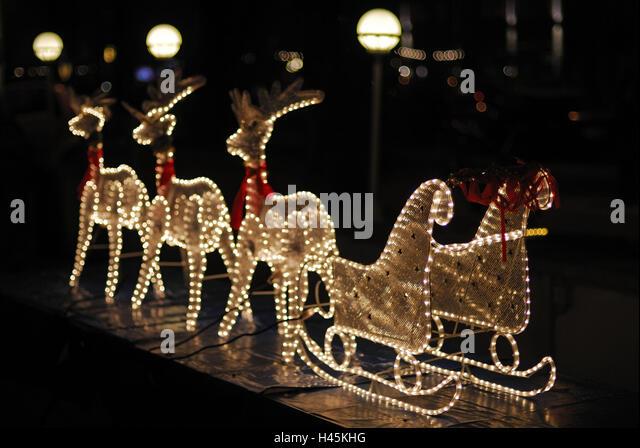 Reindeer sleighs, light hoses, night, - Stock Image