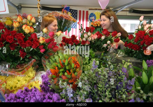 Cleveland Ohio Westside Market produce flowers women - Stock Image