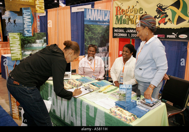 Miami Beach Florida Convention Center ING Marathon Race Fitness Expo vendor runner Jamaica promotion - Stock Image
