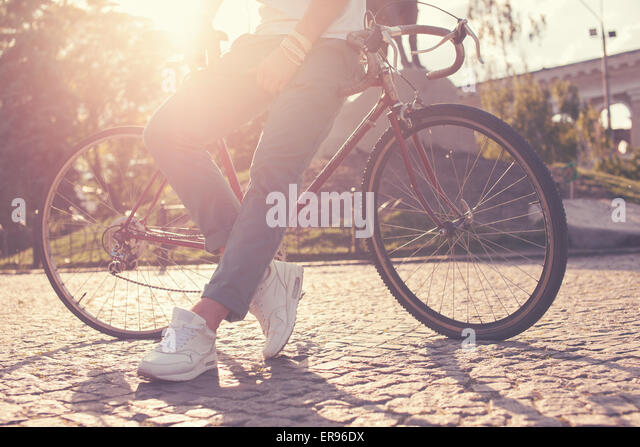 Stylish guy posing with vintage race bike - Stock Image