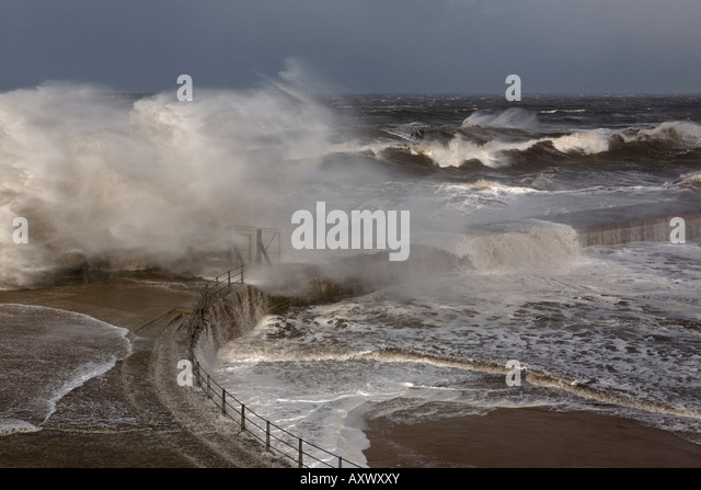 A violent and severe gale blows huges waves through the locked gates of Seaham Pier in County Durham - Stock Image