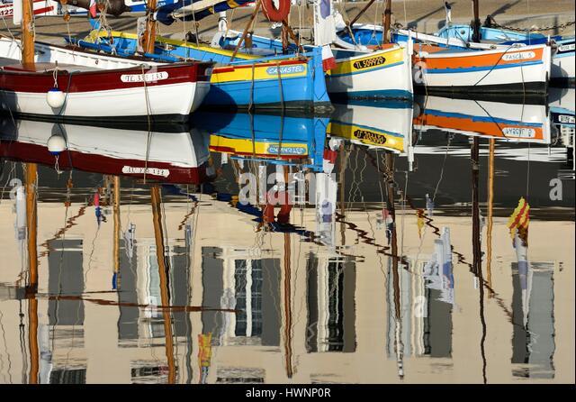 France, Var, Sanary sur Mer, the port, traditional fishing boats, the Pointus, Hotel de la Tour, reflections - Stock-Bilder