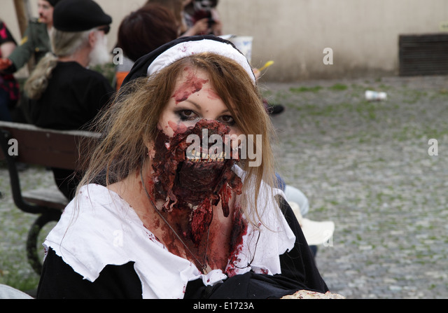 Woman dressed up to participate in the Zombie Walk in Prague in May 2014, wearing a black and white dress, and with - Stock Image