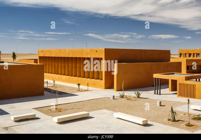 Elevated view towards square and buildings. Laayoune Technology School, Laayoune, Morocco. Architect: Saad El Kabbaj, - Stock-Bilder