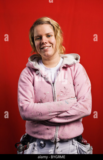 Studio portrait of female construction painter - Stock Image