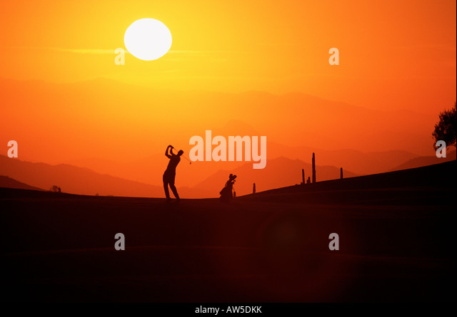 Silhouetted golfer,Geronimo course - Stock Image