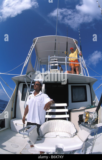 Grand Cayman sport fishing offshore fishing sport fishing boat anglers fighting chair deep sea fishing - Stock Image