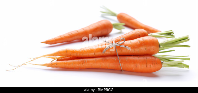 Ripe fresh carrots on a white background. - Stock Image