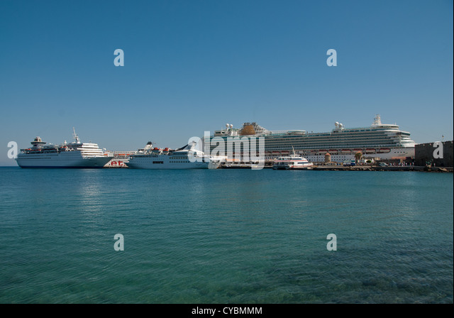 Cruise Liners and Ferry berthed in Rhodes Town - Stock Image