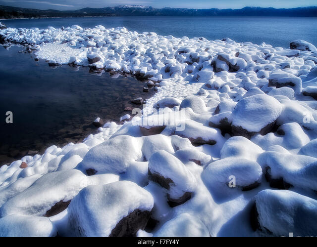 New snow on shore of Lake Tahoe, California - Stock Image