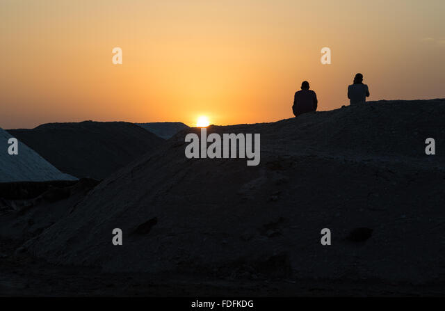 Sunset over the evaporation pools at the salt mines of Afrera - Stock Image
